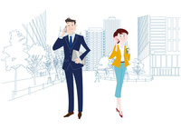 オフィス前で携帯電話で通話をするオフィスのビジネスマンとビジネスウーマン