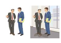 社内の廊下で上司と談笑する若手社員