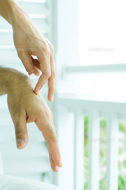 Woman touching man's hands with fingers