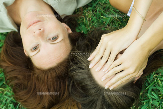 Mother & daughter lying on the ground