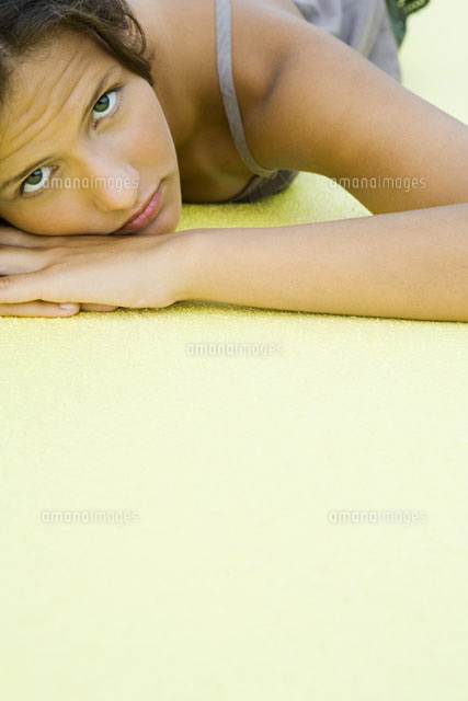 girl with head resting on arms