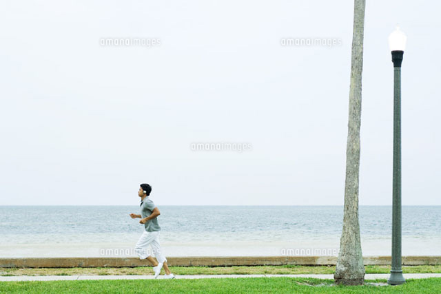 Man running and listening to headphones