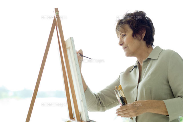woman painting canvas