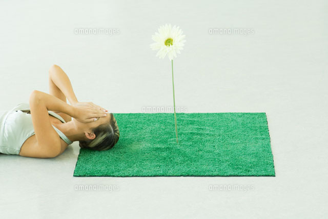 Woman with square of artificial turf