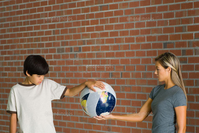 Boy & woman holding bandaged globe