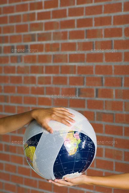 Hands holding a bandaged globe