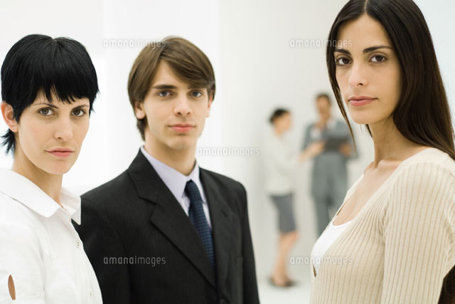 Three business associates looking