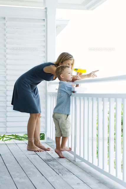 Mother & son standing on porch together