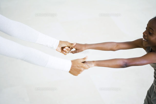 girl holding woman's hands