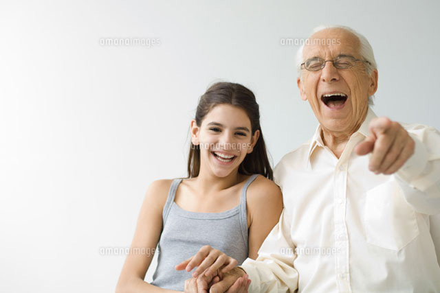Teenage girl side by side with grandfather
