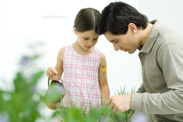 Father and girl looking at plants together