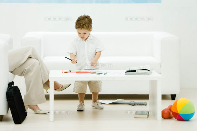 Professional woman and son in waiting room, boy coloring