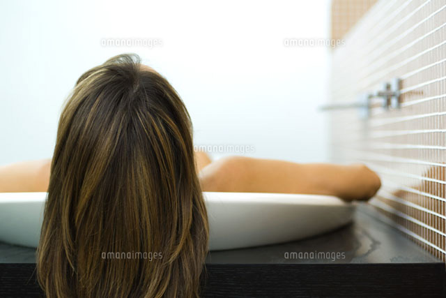 Woman in bathtub,view of back of head,close-up