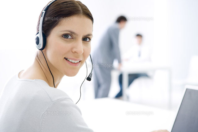 Woman wearing headset,sitting at computer