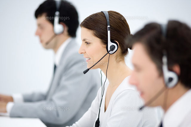 Call center,focus on woman wearing headset