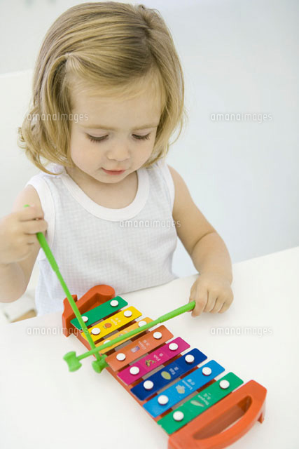 Toddler girl playing xylophone,high angle view