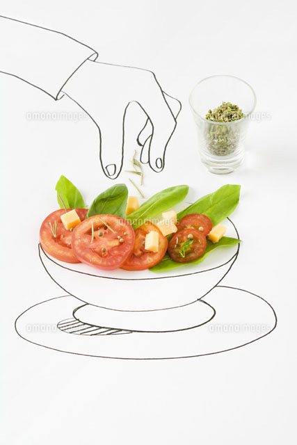 Drawing of hand sprinkling seasonings on salad