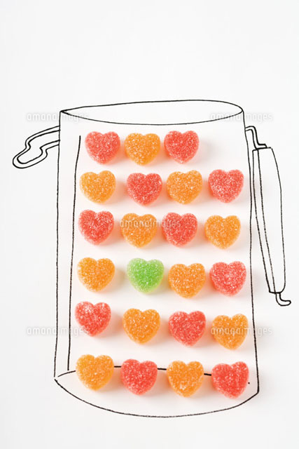 Candy hearts in drawing of canister