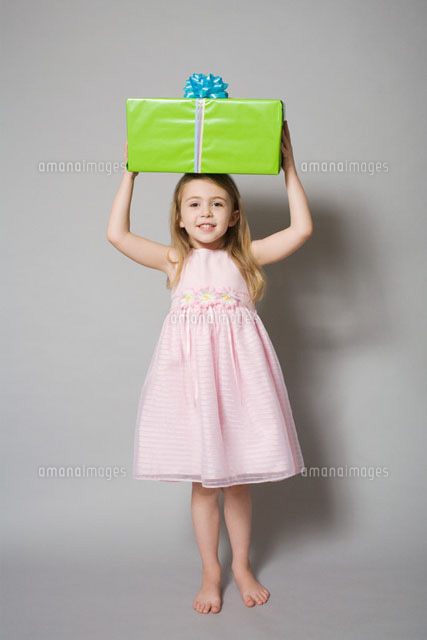 Girl holding a birthday gift