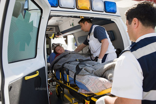 Ambulance staff and patient on stretcher