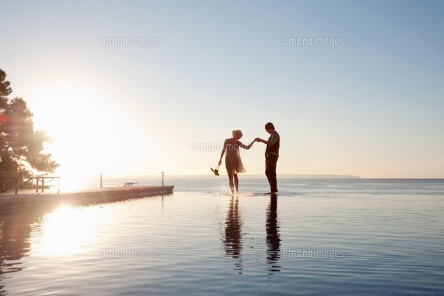 Couple in the ocean at sunset