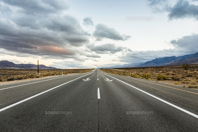 straight road with direction arrows in death valley national park