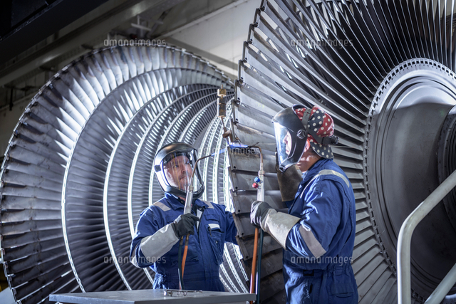 engineers brazing ends of blades on low pressure steam turbine in