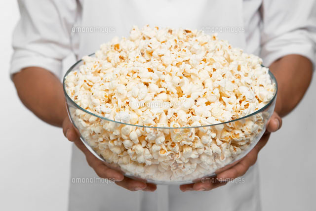 Chef holding bowl of popcorn
