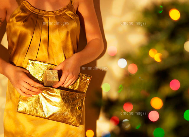 Woman Putting Present into Purse