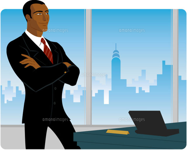 Businessman beside desk in office