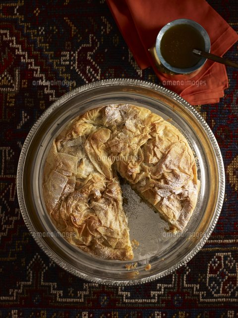 overhead view of meat pie with slice missing studio shot