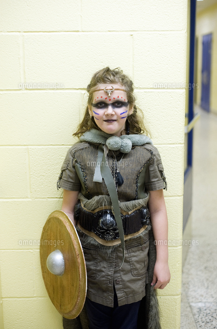 girl dressed up at school for halloween as viking shieldmaiden