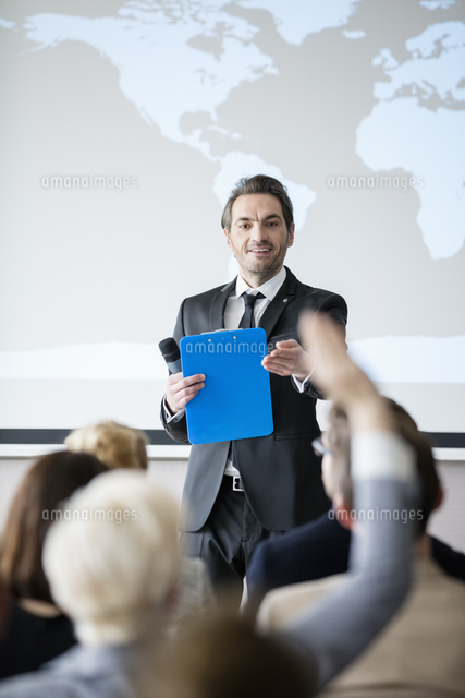 public speaker asking questions to audience during seminar