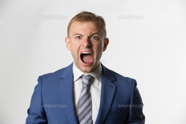 Angry Businessman screaming to camera