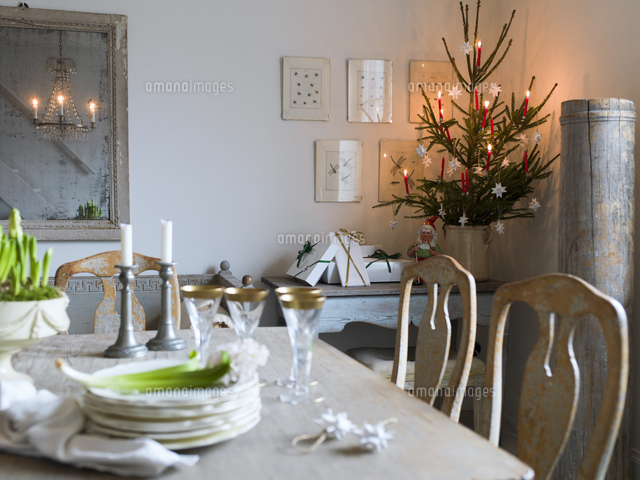 sweden elegant dining table and christmas tree in living room