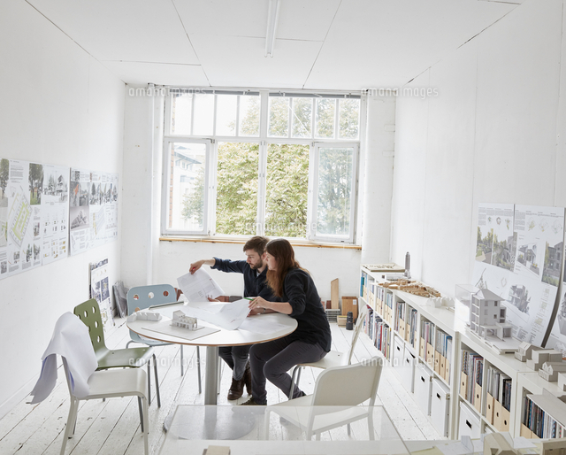 a modern office two people at a meeting discussing plans