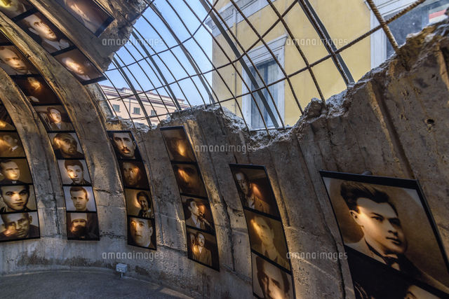 portraits of men displayed on the inside of a dome bomb damage