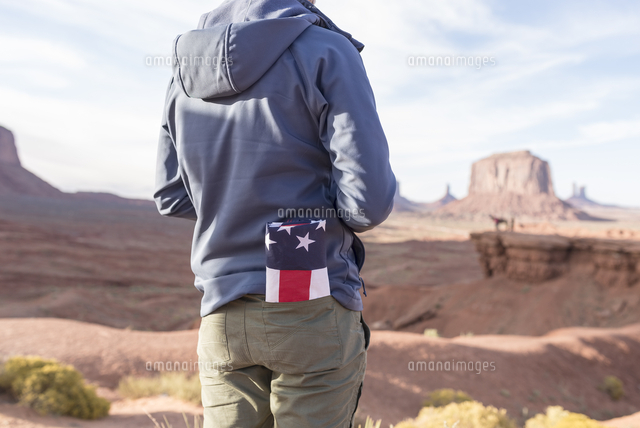 usa utah back view of young man with folded american flag