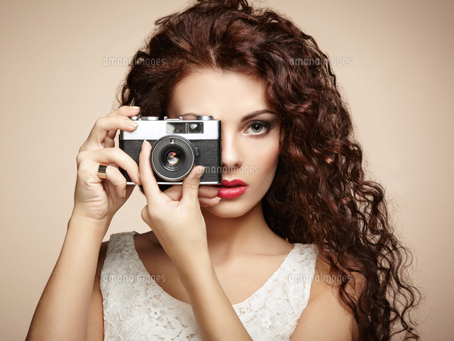 Portrait of beautiful woman with the camera girl photographer portrait of beautiful woman with the camera girl photographer coleg gekman voltagebd Gallery