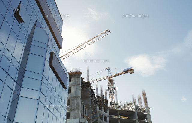 low angle view of modern office building by construction site