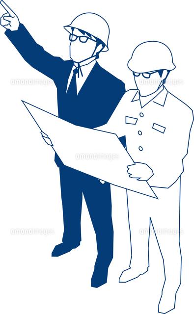 現場で指示するビジネスマン[600...