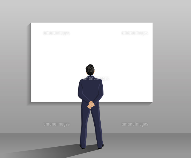 businessman in suit full length back view in front of white board