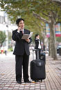 Businessman on the phone with suitcase