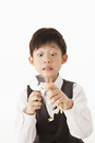 Boy observing dinosaur fossil toy with magnifying glass and