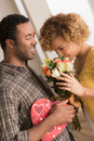 Man giving woman flowers and chocolates on valentines day