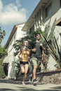 Young couple jogging in street, low angle view
