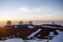 Observatory and silos on snowy mountaintop, Kilauea, Hawaii, United States