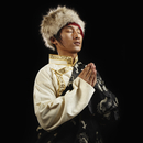 Tibetan man in traditional clothing praying