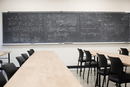 Blackboard with equations in empty classroom