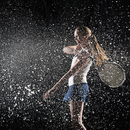 Caucasian tennis player splashing in water